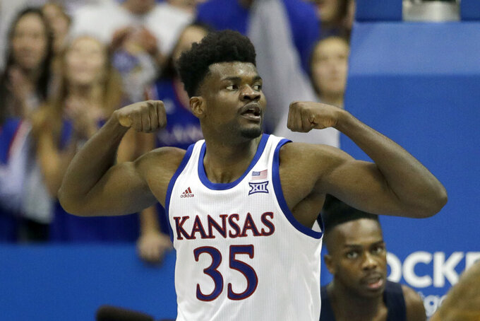 FILE - In this Nov. 8, 2019, file photo, Kansas' Udoka Azubuike celebrates after making a basket during the second half of the team's NCAA college basketball game against UNC Greensboro in Lawrence, Kan. Kansas finished the season No. 1 in The Associated Press college basketball poll, receiving 63 of 65 first-place votes from a national media panel Wednesday, March 18, 2020. (AP Photo/Charlie Riedel, File)