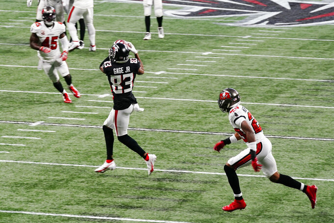 Atlanta Falcons wide receiver Russell Gage (83) makes the catch against the Tampa Bay Buccaneers during the first half of an NFL football game, Sunday, Dec. 20, 2020, in Atlanta. (AP Photo/Brynn Anderson)
