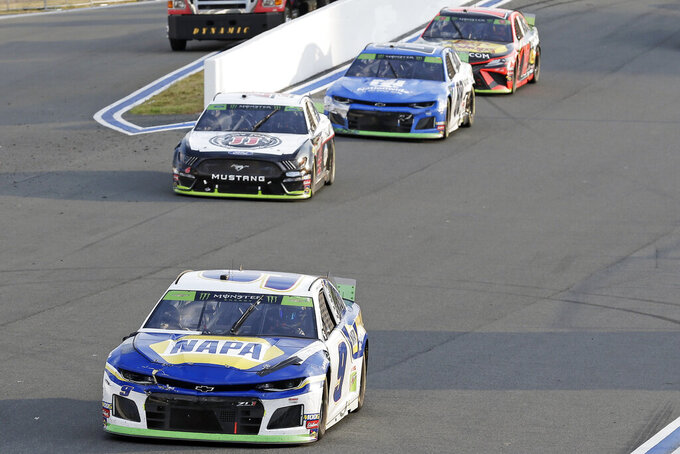 Chase Elliott leads Kevin Harvick out of Turn 2 during the closing laps of the NASCAR Cup Series auto race at Charlotte Motor Speedway in Concord, N.C., Sunday, Sept. 29, 2019. Elliott won the race. (AP Photo/Gerry Broome)
