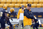 FILE - In this Oct. 10, 2015, file photo, Kennesaw State head coach Brian Bohannon watches the team warm up before an NCAA college football game in Kennesaw, Ga. Are you ready for some (more) football! No need to take a break from the gridiron just because the NFL season is over. Lower-division college teams are ready to kick off their seasons -- snow-covered fields and all -- after sitting out the fall because of the pandemic. (AP Photo/Lisa Marie Pane, File)