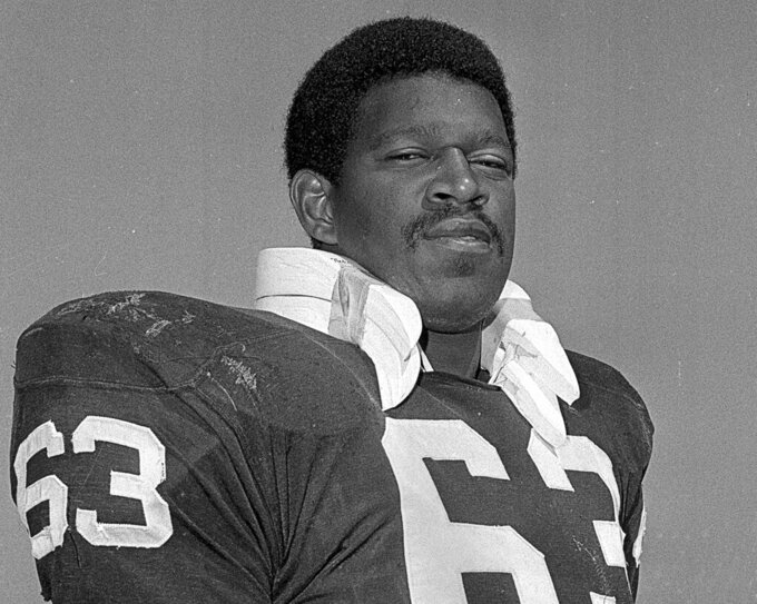 FILE - In this Aug. 15, 1970, file photo, Gene UpShaw poses when he was playing left guard for the Oakland Raiders. Al Davis found one of the key building blocks for the Raiders at overlooked Texas A&I University when he drafted Upshaw 17th overall in 1967. Upshaw became a stalwart at left guard on Oakland's overpowering line, helping the franchise win two Super Bowl titles on the way to the Hall of Fame. (AP Photo/File)