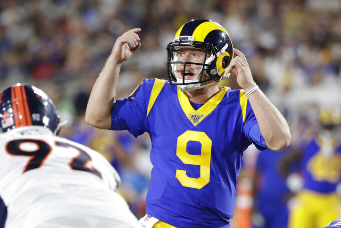 FILE - In this Saturday, Aug. 24, 2019 file photo, Los Angeles Rams quarterback John Wolford (9) gestures during an NFL preseason football game against the Denver Broncos in Los Angeles. Wolford will make his NFL debut for the Rams on Sunday,  Jan. 3, 2021 against Arizona after nearly two full seasons as a backup in which he never took a snap. Wolford says he is confident in his ability to succeed with no experience. (AP Photo/Rick Scuteri, File)