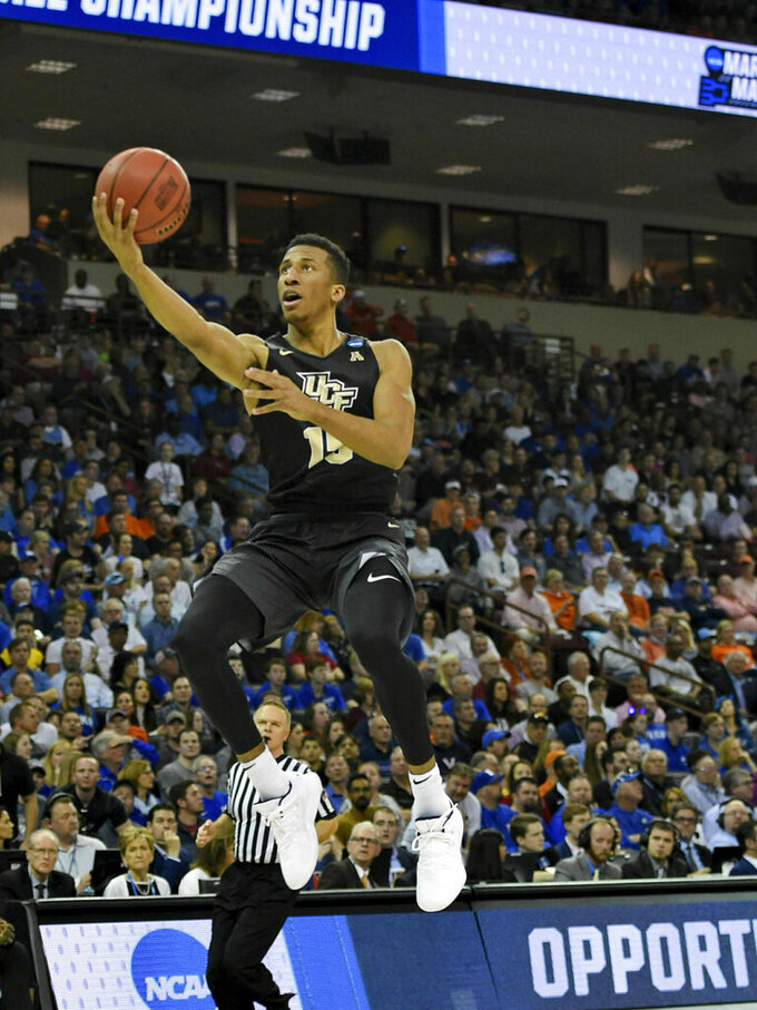CORRECTS TO SECOND ROUND NOT FIRST Central Florida's Aubrey Dawkins drives in for a layup during the first half of a second round men's college basketball game against Duke in the NCAA Tournament in Columbia, S.C. Sunday, March 24, 2019. (AP Photo/Richard Shiro)