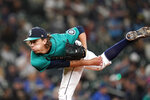 Seattle Mariners starting pitcher Logan Gilbert follows through against the Kansas City Royals in the third inning of a baseball game Friday, Aug. 27, 2021, in Seattle. (AP Photo/Elaine Thompson)