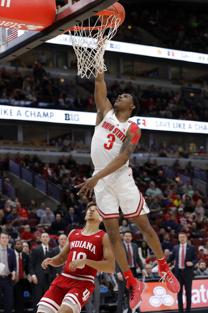 Ohio State's C.J. Jackson (3) goes upon for a lay up against Indiana's Rob Phinisee (10) during the second half of an NCAA college basketball game in the second round of the Big Ten Conference tournament, Thursday, March 14, 2019, in Chicago. (AP Photo/Nam Y. Huh)