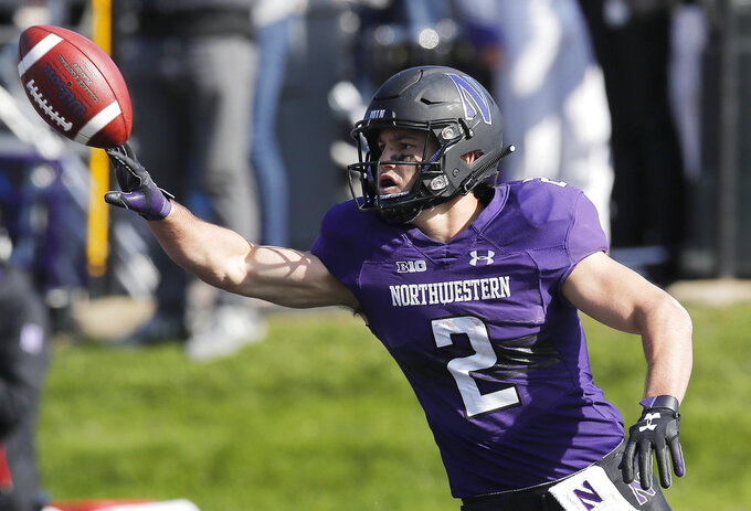 Northwestern's Flynn Nagel celebrates his touchdown against Nebraska during the second half of an NCAA college football game Saturday, Oct. 13, 2018, in Evanston, Ill.. (AP Photo/Jim Young)