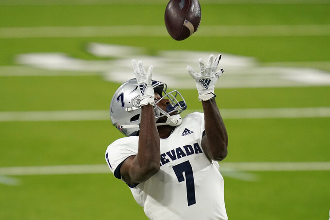 Nevada wide receiver Romeo Doubs catches a pass against during the first half of the team's NCAA college football game against UNLV on Saturday, Oct. 31, 2020, in Las Vegas. (AP Photo/John Locher)
