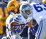 Kansas State running back Deuce Vaughn (22) rushes the ball against West Virginia during an NCAA college football game, Saturday, Oct. 31, 2020, in Morgantown, W.Va. (William Wotring/The Dominion-Post via AP)