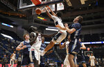 Connecticut's James Bouknight dunks a rebound from his own shot during the second half of an NCAA college basketball game against Maine, Sunday, Dec. 1, 2019, in Hartford, Conn. (AP Photo/Jessica Hill)