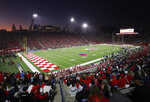 FILE - In this Nov. 9, 2019, file photo, The Bulldog Stadium is seen during the Fresno State versus Utah State game in the first half of an NCAA college football game in Fresno, Calif. This season, 39 major college football schools have scheduled 49 so-called buy games worth an estimated $65 million. If coronavirus disruptions cause Power Five teams to play more or only conference games, stretched athletic budgets could face huge holes. (AP Photo/Gary Kazanjian, File)