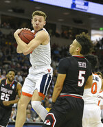 Virginia's Kyle Guy (5) grabs the rebound against Gardner-Webb's Jose Perez (5) during a first-round game in the NCAA men's college basketball tournament in Columbia, S.C. Friday, March 22, 2019. (AP Photo/Richard Shiro)