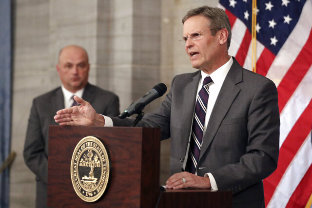 Tennessee Gov. Bill Lee, right, answers questions concerning the state's response to the coronavirus Monday, March 16, 2020, in Nashville, Tenn. Lee has asked all schools in Tennessee to close by the end of the week due to coronavirus spreading across the state. (AP Photo/Mark Humphrey)