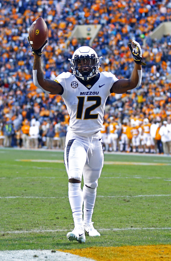 Missouri wide receiver Johnathon Johnson (12) reacts to catching a touchdown pass in the first half of an NCAA college football game against Tennessee Saturday, Nov. 17, 2018, in Knoxville, Tenn. (AP Photo/Wade Payne)