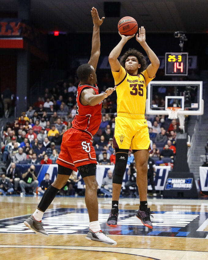 Arizona State's Taeshon Cherry (35) shoots over St. John's Mustapha Heron during the first half of a First Four game of the NCAA men's college basketball tournament Wednesday, March 20, 2019, in Dayton, Ohio. (AP Photo/John Minchillo)