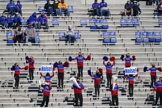 Kansas cheerleaders perform during the first half of an NCAA college football game against Iowa State in Lawrence, Kan., Saturday, Oct. 31, 2020. (AP Photo/Orlin Wagner)