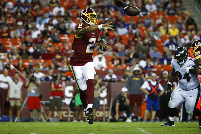 Washington Redskins quarterback Jalan McClendon (2) passes the ball during the second half of an NFL preseason football game against the Baltimore Ravens, Thursday, Aug. 29, 2019, in Landover, Md. (AP Photo/Alex Brandon)