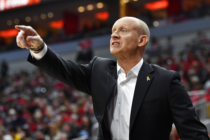 Louisville head coach Chris Mack shouts instructions to his team during the first half of an NCAA college basketball game against Clemson in Louisville, Ky., Saturday, Jan. 25, 2020. (AP Photo/Timothy D. Easley)