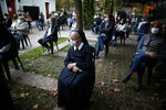 Faithful attend Mass outside the Schoenstatt shrine during Easter in Buenos Aires, Argentina, Thursday, April 1, 2021. The Mass was held outside to avoid the spreading of COVID-19. (AP Photo/Natacha Pisarenko)