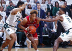 Indiana's Romeo Langford, center, drives between Michigan State's Kenny Goins, left, and Aaron Henry (11) during the first half of an NCAA college basketball game, Saturday, Feb. 2, 2019, in East Lansing, Mich. (AP Photo/Al Goldis)