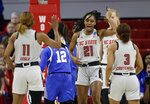 North Carolina State's Kiara Leslie (11), DD Rogers (21) and Kai Crutchfield (3) react following a play against Kentucky during the first half of a second round women's college basketball game in the NCAA Tournament in Raleigh, N.C., Monday, March 25, 2019. (AP Photo/Gerry Broome)