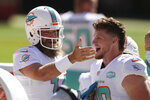 Miami Dolphins quarterback Ryan Fitzpatrick, left, gestures next to wide receiver Adam Shasheen on the sideline during the first half of an NFL football game against the San Francisco 49ers in Santa Clara, Calif., Sunday, Oct. 11, 2020. (AP Photo/Jed Jacobsohn)