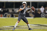 Central Florida quarterback Dillon Gabriel (11) looks for a receiver during the first half of the team's NCAA college football game against Bethune-Cookman on Saturday, Sept. 11, 2021, in Orlando, Fla. (AP Photo/John Raoux)