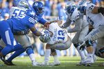 Middle Tennessee quarterback Brent Stockstill (12) is tackled behind the line of scrimmage by Kentucky defensive tackle Phil Hoskins (92) during the second half of an NCAA college football game against Kentucky in Lexington, Ky., Saturday, Nov. 17, 2018. Kentucky was penalized for a grabbing a facemark on the play. (AP Photo/Bryan Woolston)