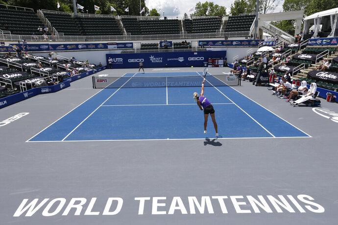 Springfield Laser tennis player Olga Govortsova delivers a serve during the World TeamTennis tournament at The Greenbrier resort Sunday July 12, 2020, in White Sulphur Springs, W.Va. (AP Photo/Steve Helber)