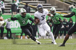 Rice quarterback JoVoni Johnson (3) rushes upfield on a keeper past Marshall defender Darius Hodge (2) during an NCAA college football game on Saturday, Dec. 5, 2020, in Huntington, W.Va.  (Sholten Singer/The Herald-Dispatch via AP)