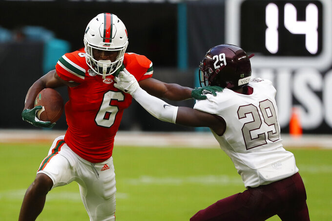 Bethune-Cookman cornerback Jamauri Laguerre (29) takes down Miami wide receiver Mark Pope (6) during the second half of an NCAA college football game, Saturday, Sept. 14, 2019, in Miami Gardens, Fla. (AP Photo/Wilfredo Lee)