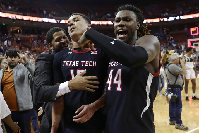 Texas Tech guard Kevin McCullar (15) and guard Chris Clarke (44) celebrate the team's 62-57 win over Texas in an NCAA college basketball game Saturday, Feb. 8, 2020, in Austin, Texas. (AP Photo/Eric Gay)