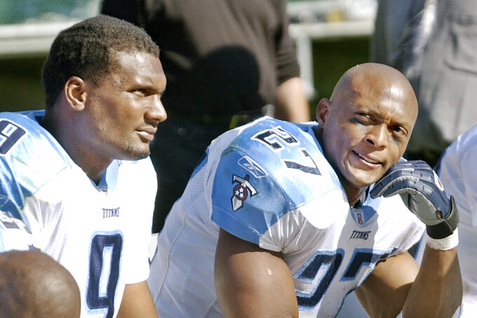 FILE - In this Sept. 29, 2002, file photo, Tennessee Titans running back Eddie George, right, and quarterback Steve McNair,  sit on the bench after the Oakland Raiders scored in the third quarter of an NFL football game in Oakland, Calif. The Titans retiring Eddie George's No. 27 and the No. 9 of the late Steve McNair has turned from a simple halftime ceremony into a celebration and team reunion. (AP Photo/Paul Sakuma, File)