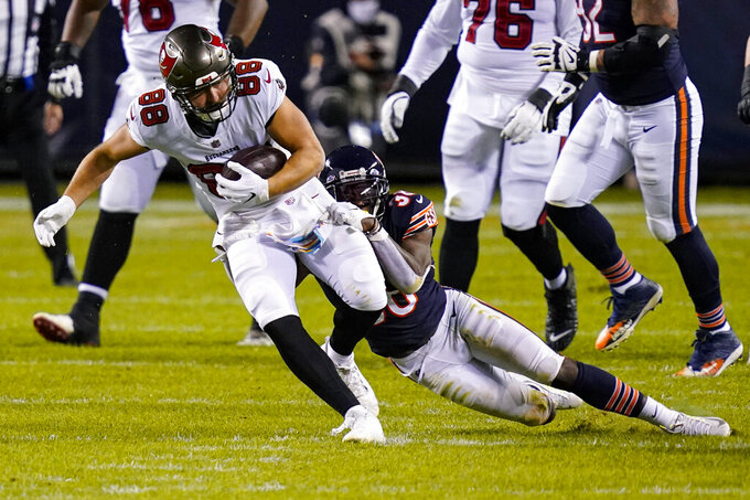 Tampa Bay Buccaneers tight end Tanner Hudson (88) is tackled by Chicago Bears safety Tashaun Gipson (38) after a catch during the first half of an NFL football game in Chicago, Thursday, Oct. 8, 2020. (AP Photo/Charles Rex Arbogast)