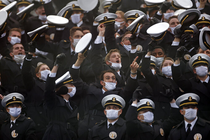 Navy Midshipmen cheer during the first half of an NCAA college football game between Navy and Army on Saturday, Dec. 12, 2020, in West Point, N.Y. (AP Photo/Adam Hunger)