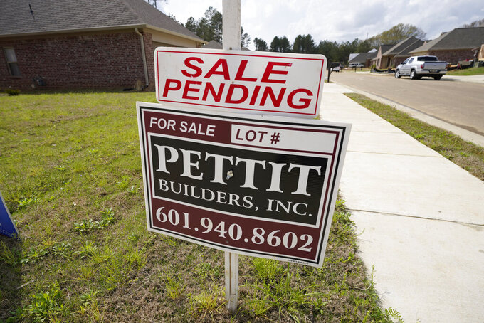 "A ""sale pending"" sign stands along side a housing lot in Madison County, Miss., Tuesday, March 16, 2021. U.S. long-term mortgage rates continued to edge higher this week as the benchmark 30-year loan stayed above the 3% mark. Rates remain near historic lows, however.  (AP Photo/Rogelio V. Solis)"