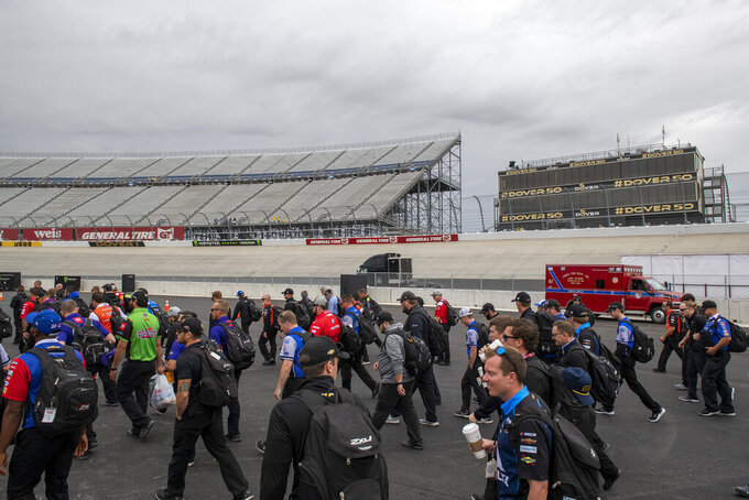 NASCAR Cup teams walk to the garage area before the Drydene 400 - Monster Energy NASCAR Cup Series playoff auto race, Sunday, Oct. 6, 2019, at Dover International Speedway in Dover, Del. (AP Photo/Jason Minto)