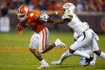Clemson running back Will Shipley (1) fends off Georgia Tech defensive back Derrik Allen (18) in the second half of an NCAA college football game Saturday, Sept. 18, 2021, in Clemson, S.C. (AP Photo/John Bazemore)