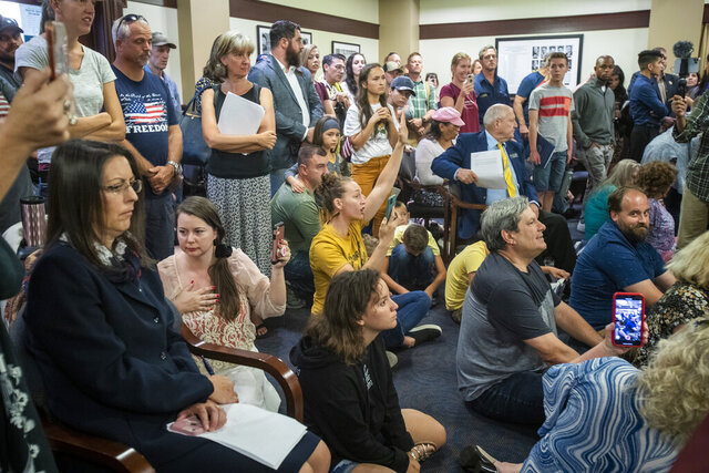 Spectators jam the House judiciary committee room, hoping that they could testify about proposed bills, although public testimony is not until later in the process, on Monday, Aug. 24, 2020. The crowd got angry when they were asked to leave unless they had a socially distanced seat. Eventually, the meeting was moved to a larger auditorium. (Katherine Jones/Idaho Statesman via AP)