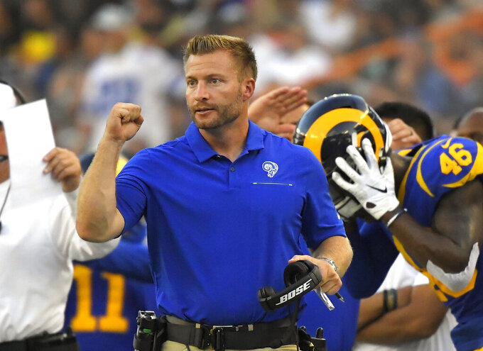 FILE - In this Aug. 17, 2019, file photo, Los Angeles Rams head coach Sean McVay gestures during the second half of a preseason NFL football game against the Dallas Cowboys in Honolulu. The Rams are the latest team to take their turn atop the NFC West pecking order. McVay led the Rams to the Super Bowl in his second season in 2018, making the division the only one of the eight in the NFL where all four teams have made it to the title game in the past 11 seasons. (AP Photo/Mark J. Terrill, File)