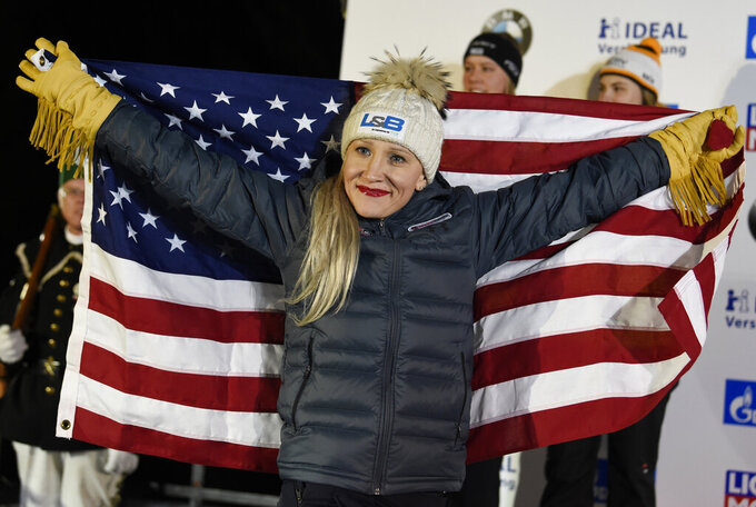 FILE - Gold medalist Kaillie Humphries of the United States celebrates during the medal ceremony for the two-woman bobsled competition at the Bobsleigh and Skeleton World Championships in Altenberg, Germany, in this Saturday, Feb. 22, 2020, file photo. The U.S. Olympic and Paralympic Committee said Tuesday, Oct. 19, 2021, that it is still trying to help world champion bobsledder Kaillie Humphries obtain a way to compete in this winter's Beijing Games. (AP Photo/Jens Meyer, File)