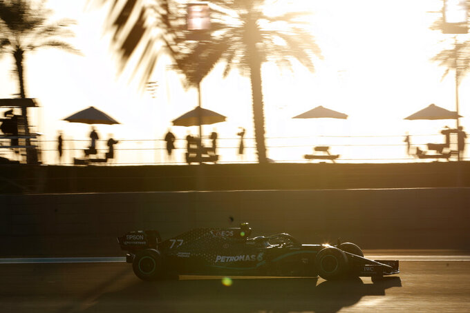 Mercedes driver Valtteri Bottas of Finland steers his car during the second free practice at the Yas Marina racetrack in Abu Dhabi, United Arab Emirates, Friday, Dec. 11, 2020. The Emirates Formula One Grand Prix will take place on Sunday. (Hamad Mohammed, Pool via AP)