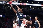 Penn State forward Lamar Stevens (11) shoots as Syracuse forward Elijah Hughes (33) defends during the second half of an NCAA college basketball game in the consolation round of the NIT Season Tip-Off tournament, Friday, Nov. 29, 2019, in New York. Penn State won 85-64. (AP Photo/Mary Altaffer)