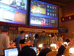 Gamblers line up to place bets on the NCAA men's college basketball tournament at the Borgata casino in Atlantic City N.J., Thursday, March 21, 2019. This is the first March Madness tournament since legal gambling expanded last year in the U.S. (AP Photo/Wayne Parry)