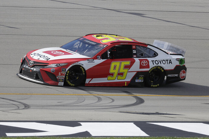 FILE - In this July 12, 2020, file photo, Christopher Bell (95) drives during a NASCAR Cup Series auto race in Sparta, Ky. Leavine Family Racing, which owns the Cup car driven by Christopher Bell, announced Tuesday, Aug. 4, 2020, it had sold its charter and will exit NASCAR at the end of the season. (AP Photo/Mark Humphrey, File)