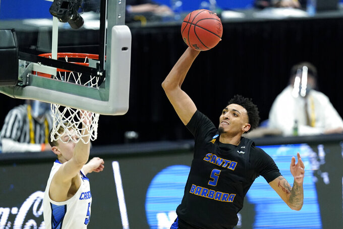 UC Santa Barbara's Miles Norris (5) scores against Creighton during the first half of a college basketball game in the first round of the NCAA tournament at Lucas Oil Stadium in Indianapolis Saturday, March 20, 2021. (AP Photo/Mark Humphrey)