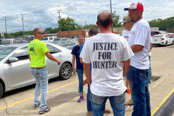 Friends and family of 17-year-old Hunter Brittain gather outside the Pope County Courthouse in Russellville, Arkansas on Friday, Sept. 17, 2021. Michael Davis, a former Lonoke County sheriff's deputy, was charged with manslaughter for fatally shooting the white teenager during a June 23, 2021 traffic stop. (AP Photo/Andrew Demillo)