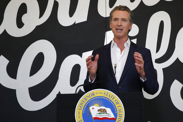 """FILE - In this May 5, 2020 file photo, California Gov. Gavin Newsom discusses his plan for the gradual reopening of California businesses during a news conference at the Display California store in Sacramento, Calif. While President Donald Trump claims mail-in voting is ripe for fraud and """"cheaters,"""" his reelection campaign and state allies are scrambling to launch operations meant to help their voters cast ballots in the mail. Newsom, a Democrat, has announced that the state's 20.6 million voters will be mailed ballots before Election Day.  (AP Photo/Rich Pedroncelli, Pool, File)"""