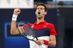 Novak Djokovic of Serbia reacts to winning the first set against Daniil Medvedev of Russia during their ATP Cup tennis match in Sydney, Saturday, Jan. 11, 2020. (AP Photo/Steve Christo)
