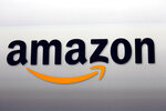 FILE - This Sept. 6, 2012 file photo shows the Amazon logo in Santa Monica, Calif. Nike is ending a sales partnership with Amazon less than a month after the athletic gear company named e-commerce veteran John Donahoe as its new CEO. (AP Photo/Reed Saxon, File)