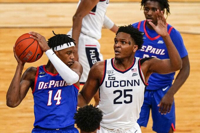Connecticut's Josh Carlton (25) defends against DePaul's Nick Ongenda (14) during the first half of an NCAA college basketball game in the Big East men's tournament Thursday, March 11, 2021, in New York. (AP Photo/Frank Franklin II)